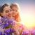 dochter · moeder · spelen · bloemen · weide · lentebloemen - stockfoto © choreograph