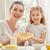 heerlijk · voedsel · moeder · dochter · meisje · kind - stockfoto © choreograph