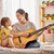 woman playing guitar for child girl stock photo © choreograph