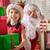 kerstman · aanwezig · weinig · cute · meisje · home - stockfoto © choreograph