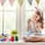 gyermek · festmény · tojások · aranyos · kicsi · visel - stock fotó © choreograph