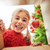 girl opening a christmas present stock photo © choreograph