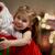 kerstman · glimlachend · meisje · huis · home - stockfoto © choreograph