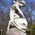 boy with dolphin sculpture in hyde park stock photo © chrisdorney
