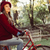 Woman in vintage fashion riding bike on fall day stock photo © cienpies