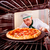 chef cooking pizza in the oven stock photo © cookelma