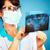 női · orvos · megvizsgál · röntgen · kép · nők - stock fotó © cookelma