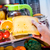 woman takes the piece of cheese from the open refrigerator stock photo © cookelma