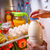 woman takes the milk from the open refrigerator stock photo © cookelma
