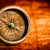 vintage compass lies on an ancient world map stock photo © cookelma