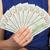 woman holding new 100 us dollar bills stock photo © courtyardpix