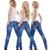 três · mulheres · jovens · em · pé · olhando · isolado - foto stock © courtyardpix