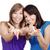młodych · kobiet · uśmiechnięty · dwa · szczęśliwy · gesty - zdjęcia stock © courtyardpix