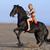 equitación · nina · playa · negro · semental - foto stock © cynoclub