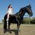 jonge · paardrijden · meisje · jong · meisje · zwarte · hengst - stockfoto © cynoclub