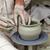 homem · trabalhando · mãos · cerâmico · ilha - foto stock © d13