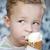 cute little boy eating an ice cream cone stock photo © d13