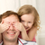 daughter playing with father closing his eyes stock photo © d13