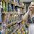élelmiszerbolt · mosolygó · nő · vásárlás · választ · gyümölcs · bevásárlókocsi - stock fotó © d13