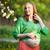 jonge · zwangere · vrouw · naar · buik · park · glimlachend - stockfoto © d13
