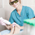 smiling cosmetician working with laser to treat feet stock photo © d13