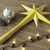 3d render of a gold star and balls Christmas decoration with black lights on wooden background stock photo © danilo_vuletic