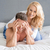 mischievous woman covering her husbands eyes stock photo © dash