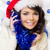 happy woman celebrating christmas in a santa hat stock photo © dash