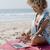 mulher · trabalhando · laptop · praia · computador · mulheres - foto stock © dash