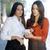 two pretty stylish women reading an sms stock photo © dash
