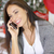 young woman making christmas calls to friends stock photo © dash