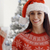 pretty young woman celebrating christmas at home stock photo © dash