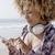 lány · tengerpart · zenét · hallgat · vicces · fiatal · lány · fülhallgató - stock fotó © dash