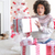 surprised woman holding a large christmas gift stock photo © dash