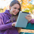 young woman using her tablet in an autumn park stock photo © dash
