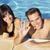 smiling couple standing in clear pool wave stock photo © dash