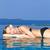 attractive woman sunbathing poolside stock photo © dash