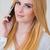 pretty woman in white calling through mobile phone stock photo © dash