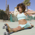 young smiling woman doing splits on playground stock photo © dash