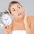 woman holding an alarm clock stock photo © dash