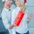 playful man giving his wife a christmas gift stock photo © dash