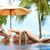 blond woman sunbathing on an infinity pool stock photo © dash