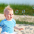 baby on the beach playing with soap bubbles stock photo © dashapetrenko
