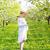 mooie · zwangere · vrouw · tuin · permanente · bomen - stockfoto © dashapetrenko