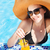 woman in a hat enjoying cocktail in a swimming pool stock photo © dashapetrenko