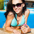 pretty woman enjoying cocktail in a swimming pool stock photo © dashapetrenko