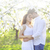 couple in love kissing and hugging in spring park stock photo © dashapetrenko