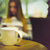 coffee cup in coffee shop and woman with mobile phone stock photo © dashapetrenko