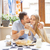 cute couple having breakfast together in the kitchen stock photo © dashapetrenko