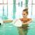 blond woman doing aqua aerobics with foam dumbbells in swimming stock photo © dashapetrenko